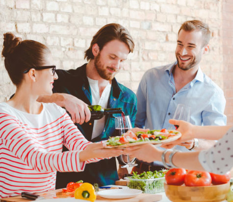 Friends-cooking-pizza-together-in-the-modern-kitchen-000076747279_Large